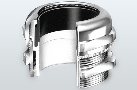 Image of a FM-HSK cable gland with a section cut out to see the cross section fo the product.