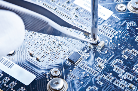 A blue PCB board with a micro screw being screwed into it