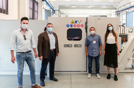 Four colleagues from TR VIC standing next to new Carlo Salvi machine