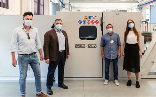 4 colleagues standing next to new Carlo Salvi machine