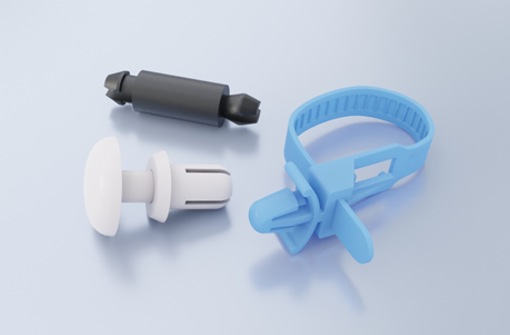 A black plastic circuit board support, a white plastic rivet and a pale blue cable tie on a light grey background